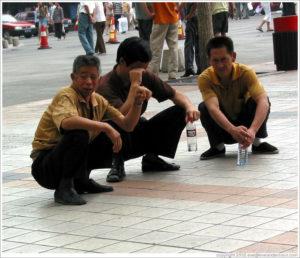 beijing-wangfujing-men-squatting-large